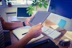 Designer working at desk using tablet Stock Images