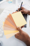 Designer working with digitizer and colour sample Stock Photos