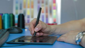 Designer working with Drawing tablet for computer stock video footage
