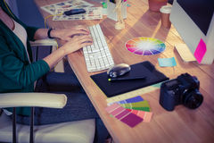 Designer working at her desk Royalty Free Stock Photos