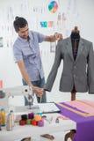 Designer working in his workshop. Handsome man asian fashion designer working in his workshop Royalty Free Stock Images