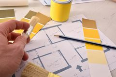 Designer working on interior home painting project elevated view. Designer working on interior home painting project. Elevated view. Horizontal composition royalty free stock image