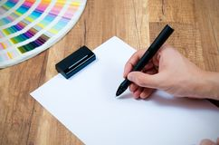 Designer working with modern digitized pen. Graphic designer working with modern digitized pen royalty free stock images