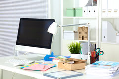 Designer working place with computer and paperwork Royalty Free Stock Images