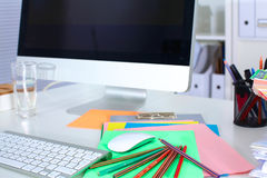 Designer working place with computer and paperwork Stock Image