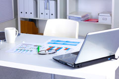 Designer working place with computer and paperwork Royalty Free Stock Image
