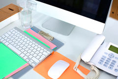 Designer working place with computer and paperwork Royalty Free Stock Photography
