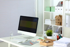 Designer working place with computer and paperwork Stock Photo
