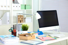 Designer working place with computer and paperwork Royalty Free Stock Photo