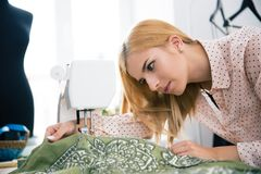 Designer working on sewing machine Stock Image