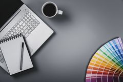 Designer workplace with color palette and laptop. top view with royalty free stock images