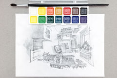 Designer workplace with freehand drawing of living room, watercolor paints, brush Royalty Free Stock Images