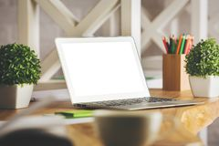 Designer workplace with white laptop Royalty Free Stock Photography