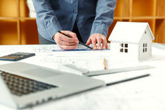 Designer works on a blueprint of new apartments Royalty Free Stock Photos