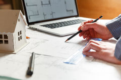 Designer works on a blueprint of new apartments Stock Images