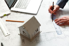 Designer works on a blueprint of new apartments Stock Image