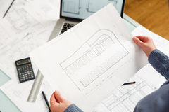 Designer works on a blueprint of new parking lot Stock Image