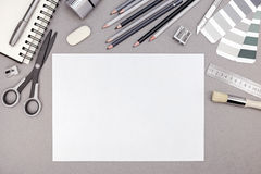 Designer workspace with blank paper, pencils, color swatches and Stock Images