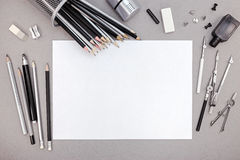 Designer workspace with blank paper, pencils and various drawing Stock Photos