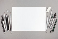 Designer workspace with blank paper sheet and various drawing to Stock Image