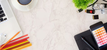 Designer workspace. Top view with essential elements on pink marble Desk royalty free stock image