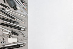 Designer workspace with various drawing tools and accessories Royalty Free Stock Photo