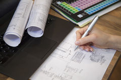 Designer writing blueprints in the office. Stock Photo
