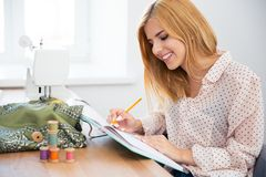 Designer writing notes Royalty Free Stock Images