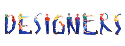 Designers. Group of young people wearing different color uniforms and hard hats forming Designers word - isolated on white background royalty free stock images