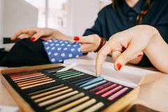 Designers choose fabrics for fashion collection royalty free stock photos