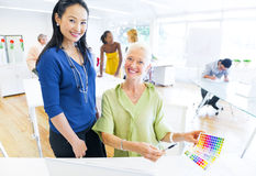 Designers Choosing Colors from the Color Swatch.  stock images
