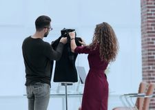 Designers clothes working in the Studio. Royalty Free Stock Photo
