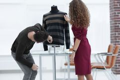 Designers clothes working in the Studio. Photo with copy space Royalty Free Stock Image
