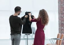Designers clothes working in the Studio. Photo with copy space Royalty Free Stock Photography