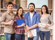 Designers. Creative group of designers dressed casual looking at camera and smiling royalty free stock images