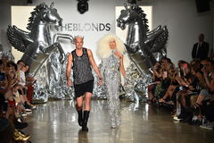 Designers David Blond and Phillipe Blond appear on the runway at The Blonds fashion show Stock Photography
