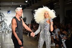 Designers David Blond and Phillipe Blond appear on the runway at The Blonds fashion show Stock Images