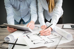 Designers discuss the sketches inside the house. Interior design designer planning architecture drawing architect business plan construction sketch concept Royalty Free Stock Images