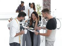 Designers discussing the design of the male suit. In the Studio Royalty Free Stock Images