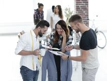Designers discussing the design of the male suit. In the Studio Stock Image
