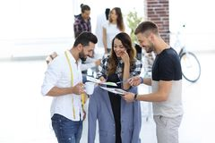 Designers discussing the design of the male suit. In the Studio Stock Images