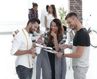 Designers discussing the design of the male suit. In the Studio Royalty Free Stock Image