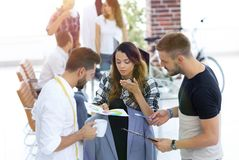 Designers discussing the design of the male suit. In the Studio Royalty Free Stock Photo