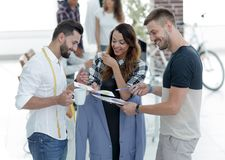 Designers discussing the design of the male suit. In the Studio Stock Photo
