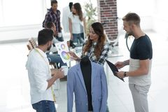 Designers discussing the design of the male suit. In the Studio Stock Photography