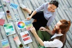Designers Enjoying Work Royalty Free Stock Image