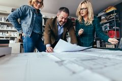 Designers finalize a housing construction plan Stock Photography