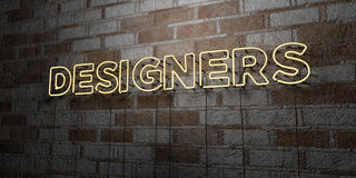 DESIGNERS - Glowing Neon Sign on stonework wall - 3D rendered royalty free stock illustration Royalty Free Stock Images