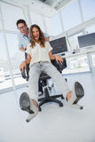Designers having fun with on a swivel chair Stock Image