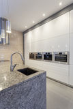 Designers interior - Closeup of kitchen. Interior, faucet and shelves royalty free stock photography